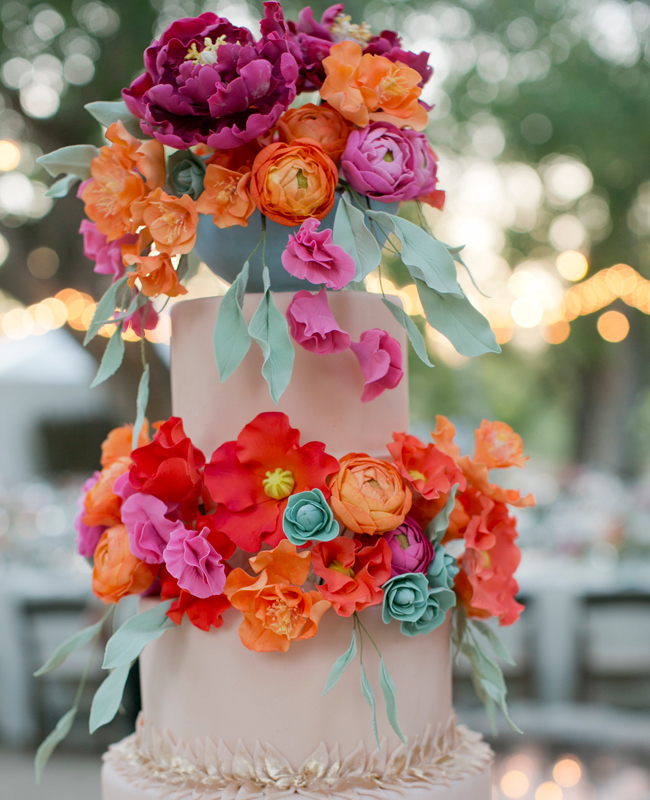 Vibrant pink and orange wedding cake